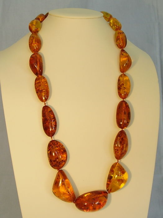 A big vintage amber necklace made of natural, tested amber stones .