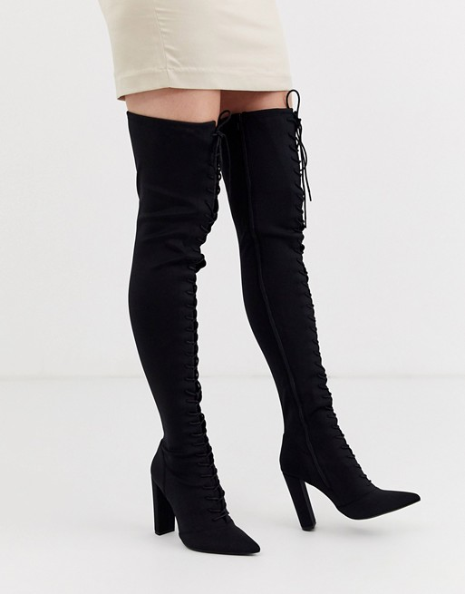 ASOS DESIGN Knowledge lace up thigh high boots in black | AS