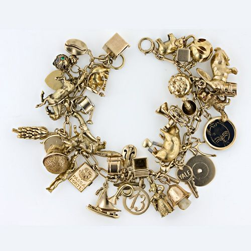 1940's Charm Bracelet. 14kt. Gold. I would die for this. So neat .