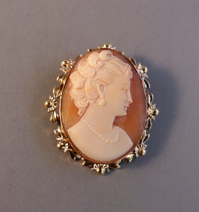 CAMEO brooch with a sea shell cameo of a lady's profile - $68.00 .
