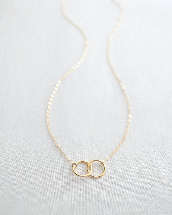 Double Trouble Necklace by Olive Yew features 2 linked circles .