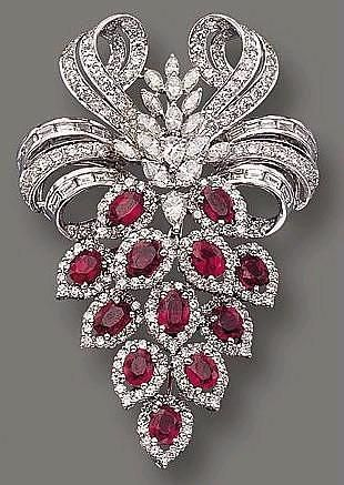 Ruby and diamond brooch cartier, I would wear it in my hair .
