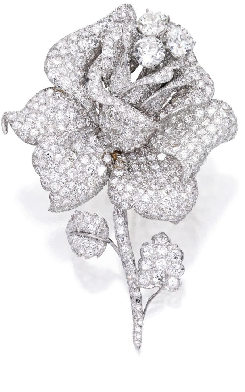 A rose blossom. Platinum and diamond brooch, David Webb .