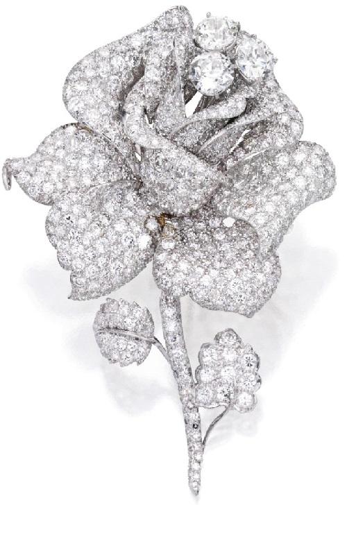A rose blossom. Platinum and diamond brooch, David Webb .