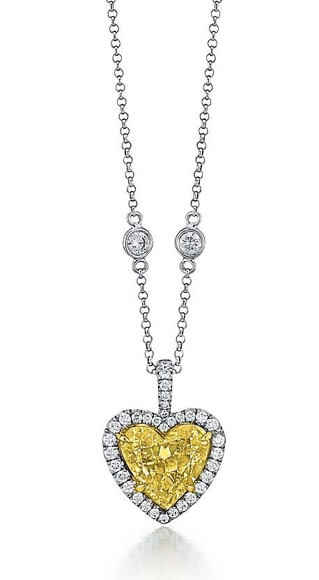 Fancy Intense Yellow heart shape diamond pendant - Fancy Color .