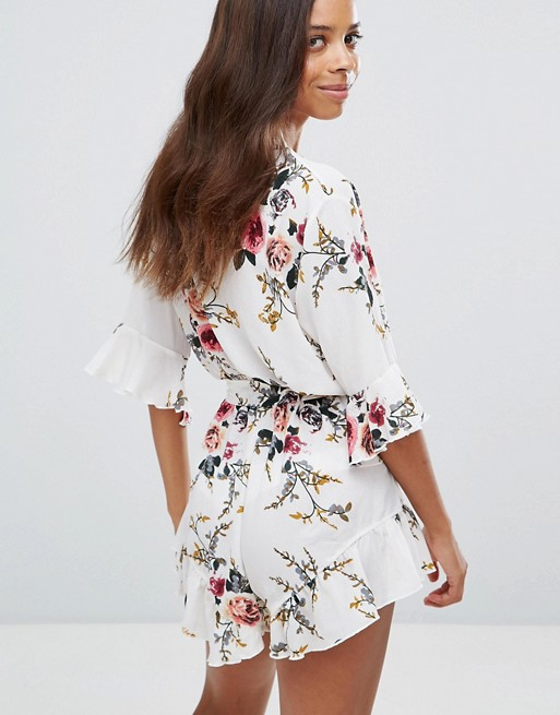 Boohoo Petite Ruffle Hem Floral Wrap Playsuit | AS