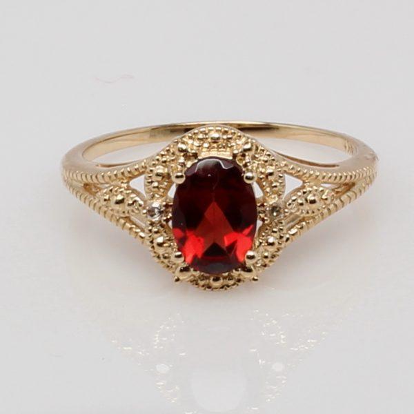 14 Karat Yellow Gold and Diamond Accent Oval Garnet Ring .