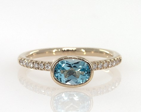 fashion rings, gemstone rings, 18k yellow gold east west oval blue .