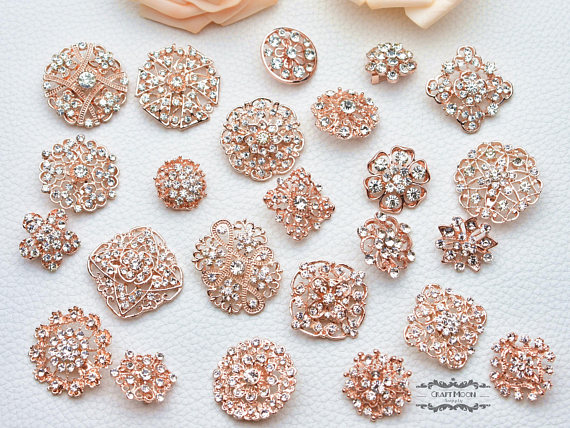 This listing is for 24 pieces assorted rose gold rhinestone brooch .
