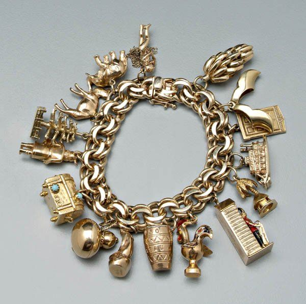 Lot: 1219: Tiffany gold charm bracelet,, Lot Number: 1219 .
