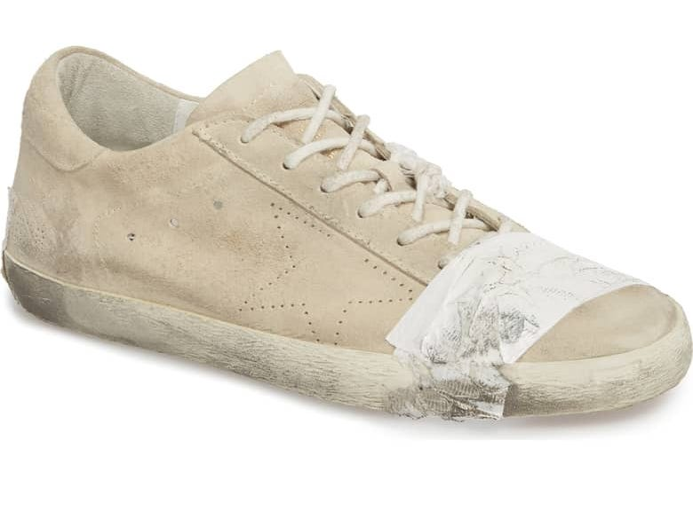 People think $530 Golden Goose taped sneakers are problematic .