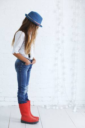 Cute Teenage Girl 8-9 Years Old Wearing Trendy Hipster Clothes .