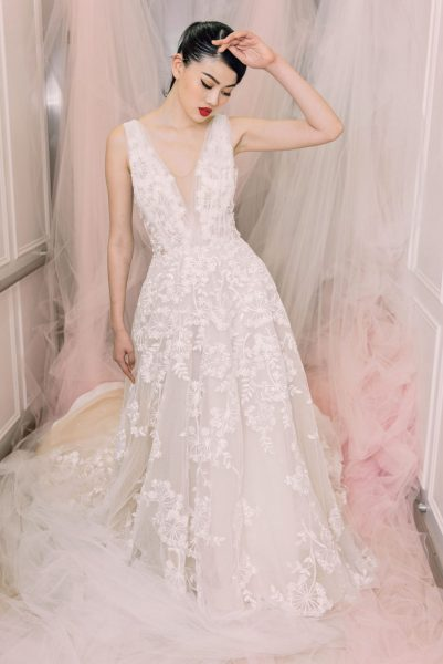 Sleeveless V-neck Beaded And Embroidered Lace Wedding Dress .
