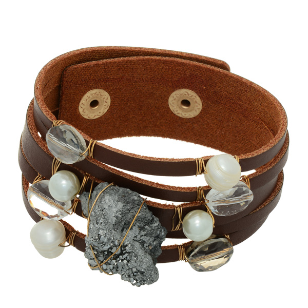 Brown faux leather cuff bracelet featuring a silver wire wrapped .