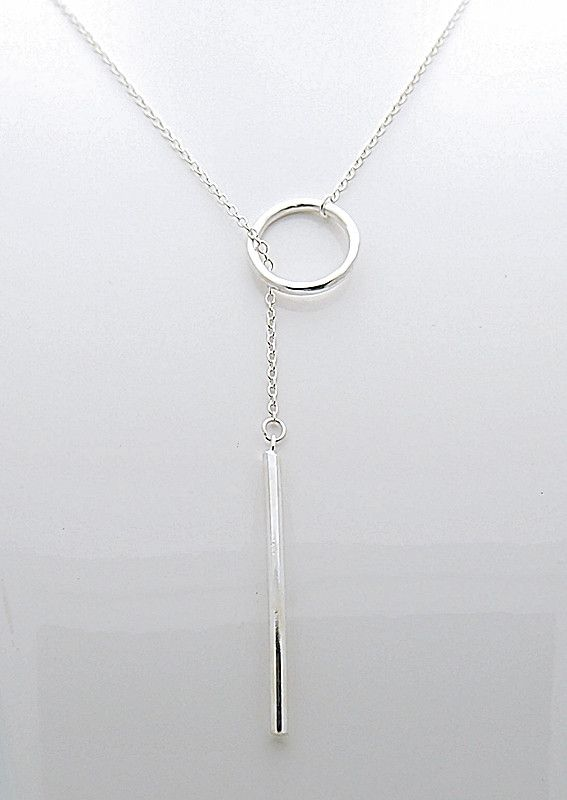 The process of adorning your neck with long silver necklace .