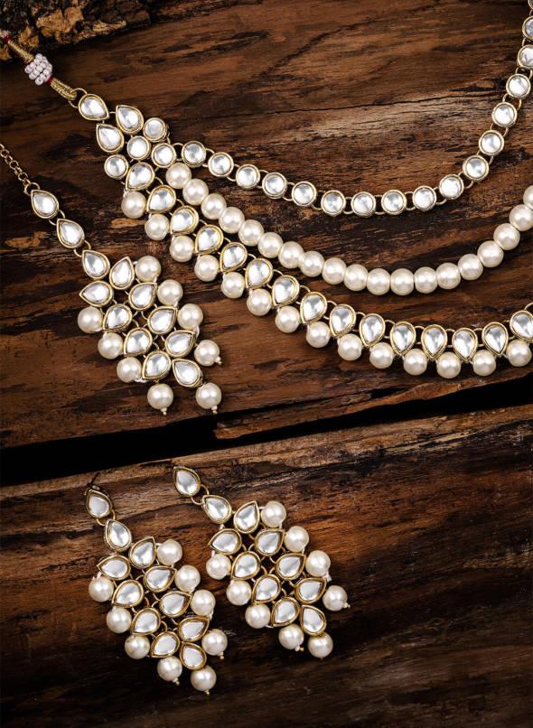 Buy Zaveri Pearls Gold Toned Kundan & Pearl Jewellery Set Online .