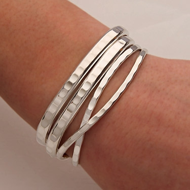 Handcrafted Sterling Silver Cuff Bracelets from David Smallcombe .
