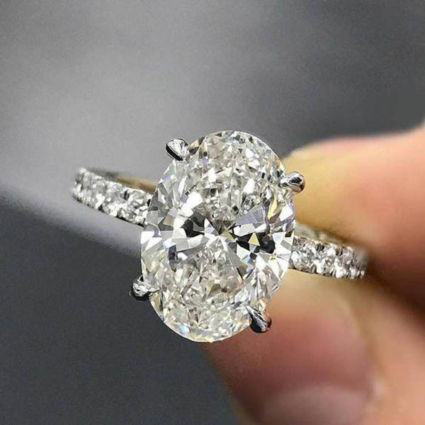 Pretty Oval Cut White Sapphire Sterling Silver Engagement Ring .