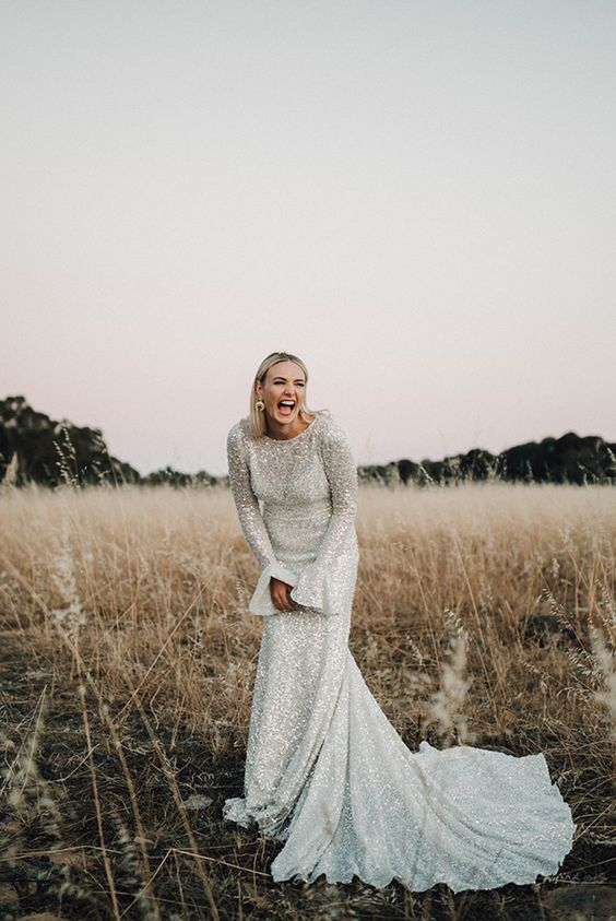 Picture Of a sheath silver wedding dress with bell sleeves and a .