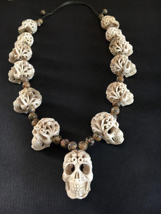 Hand carved SKULL necklace - deer horn / jasper gemstone beads .