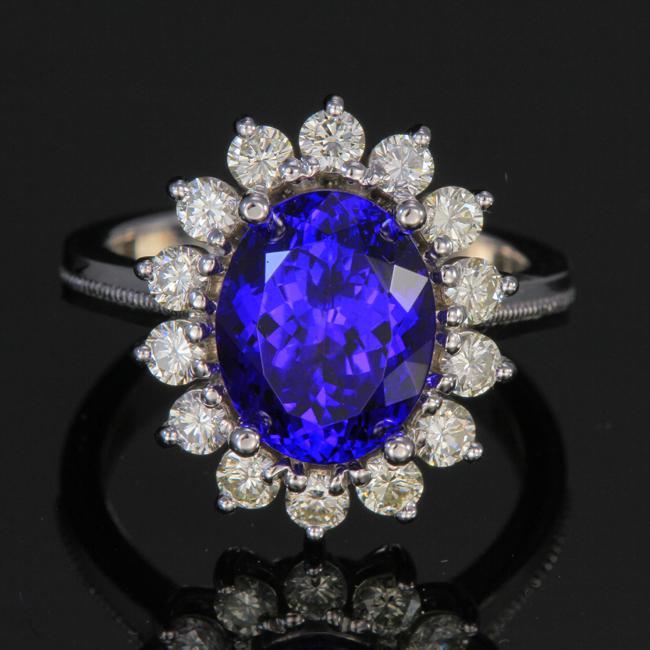 18k White Gold Tanzanite Ring with Halo of Diamonds 4.72 Carats .