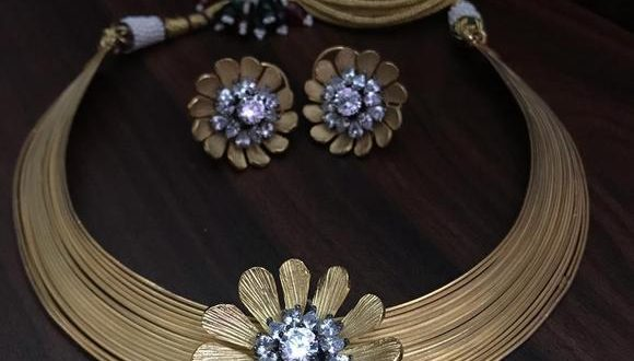 Gold Hand crafted fine stylish Trendy Jewellery Set for Women .