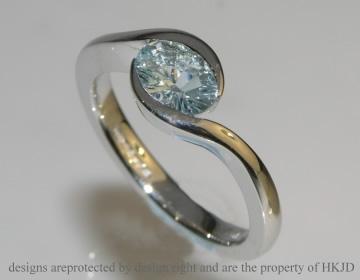9ct white gold engagement ring with unusual lazer cut aquamari