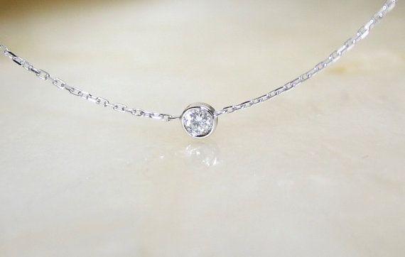 Solitaire diamond and 18k white gold necklace, Bezel set diamond .