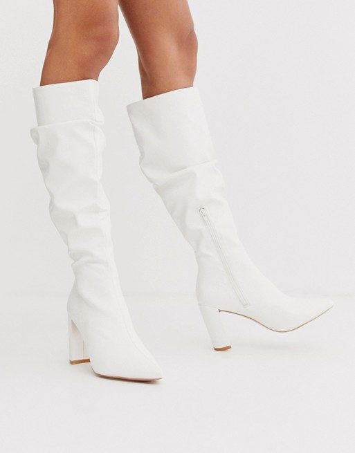 Boohoo exclusive knee high boots with block heel in white | AS