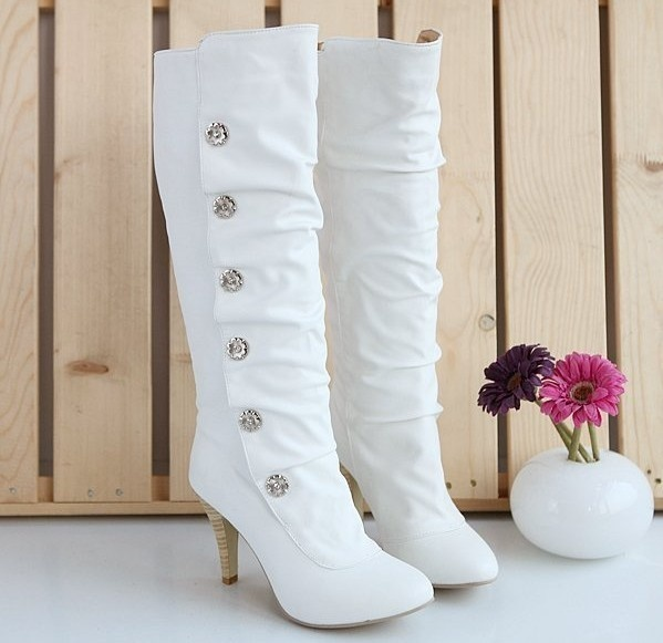 Picture Of white tall boots with rhinestone buttons and heels will .