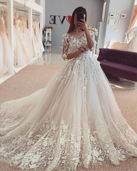 Beautiful Floral Lace Wedding Bridal Gown with Sleeves .
