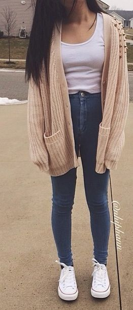 high waisted dark jeans white top beige tan knitted cardigan white .