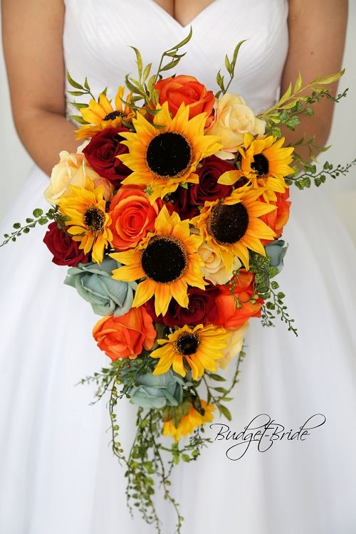 Cascading teardrop wedding flower bouquet with sunflowers and .