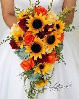 Cascading wedding flower brides bouquet with sunflowers, orange .