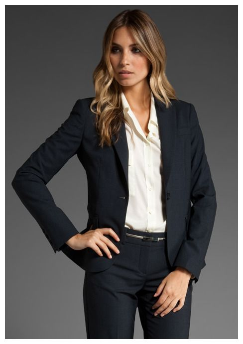Theory classic black pant suit and white blouse for wofor work .