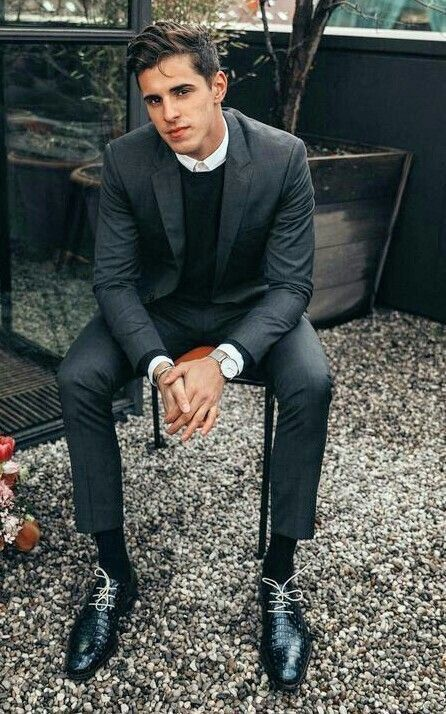 Monochrome business casual inspiration with a charcoal sweater .