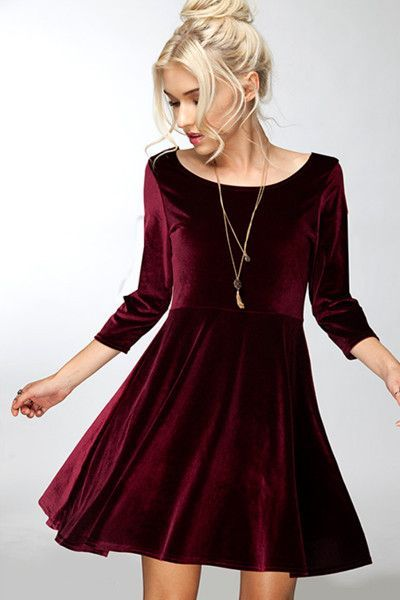 This chic and flirty velvet dress is perfect for any winter event .