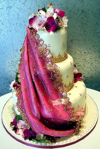 Vibrant Pink Sari Design on an Indian inspired tiered Wedding Cake .